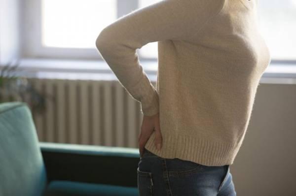 Боли в пояснице у женщин: причины и лечение